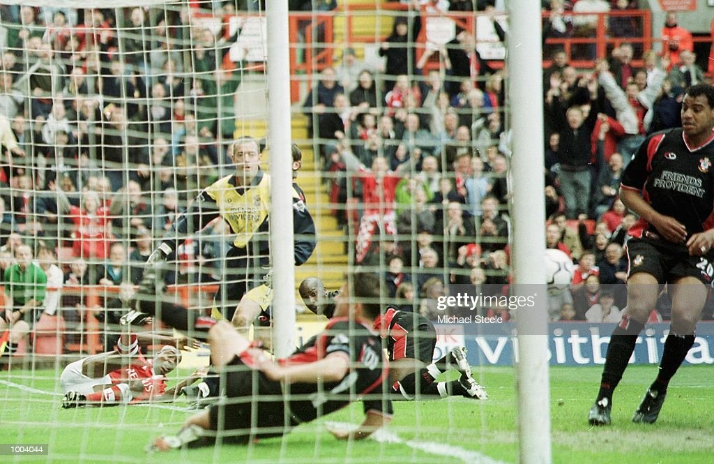 Southampton Captain Jason Dodd tries in vain to kick the ball clear from the goal, giving Richard Rufus the opening goal during the FA Barclaycard Premiership match between Charlton Athletic and Southampton at The Valley, London. DIGITAL IMAGE. Mandatory Credit: Michael Steele/Getty Images