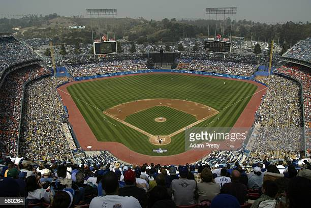 Starting pitcher Kevin Brown of the Los Angeles Dodgers delivers the first pitch to Tsuyoshi Shinjo of the San Francisco Giants on Opening Day at...