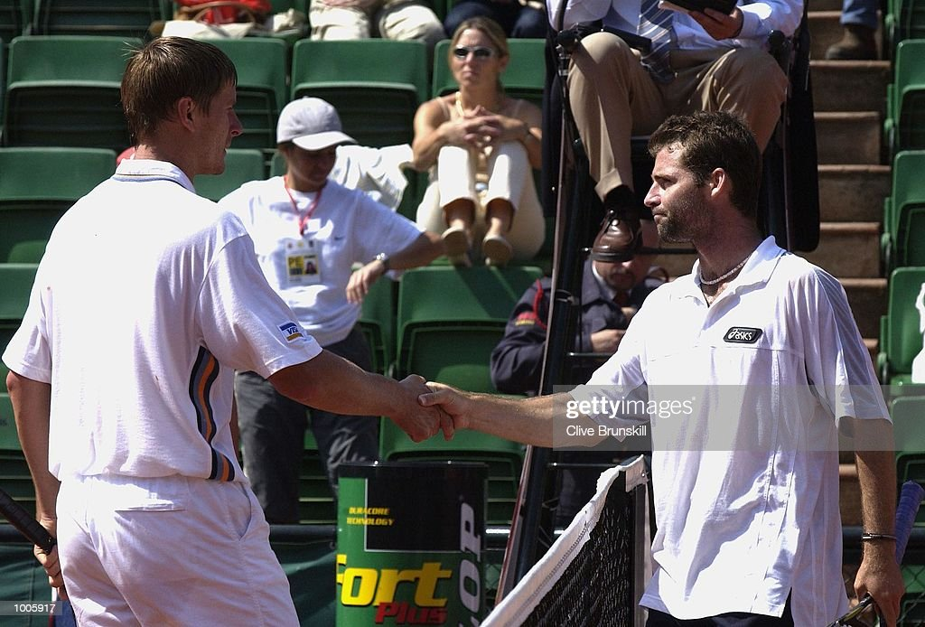 Stefano Galvani of Italy shakes hands at the net after defeating Yevgeny Kafelnikov of Russia during the Open Seat Godo 2002 held in Barcelona, Spain. DIGITAL IMAGE Mandatory Credit: Clive Brunskill/Getty Images