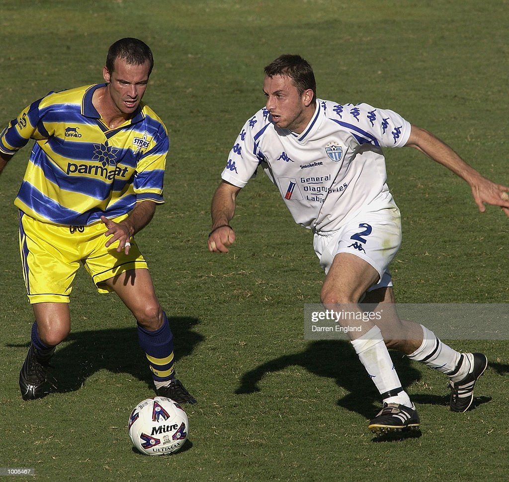 Steve Iosifidis #2 of South Melbourne gets past Paul Foster #9 of Brisbane during the NSL second leg of the Elimination Final series played between the Brisbane Strikers and South Melbourne played at Ballymore in Brisbane, Australia. DIGITAL IMAGE. Mandatory Credit: Darren England/Getty Images