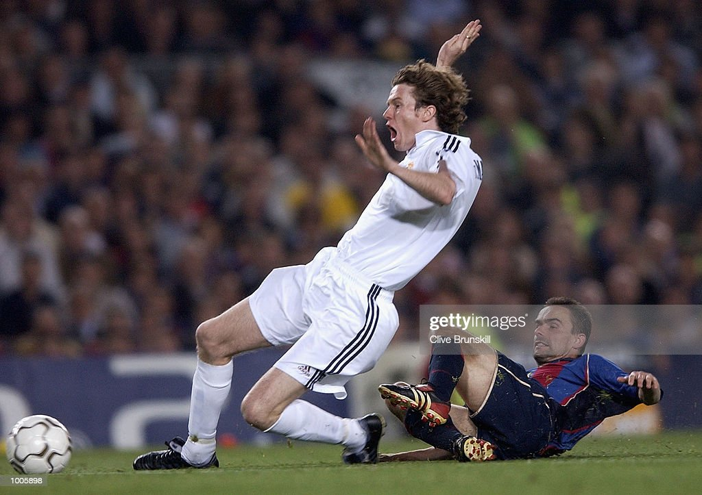 Steve McManaman of Real Madrid is tackled by Marc Overmars of Barcelona during the UEFA Champions League Semi Final First Leg match between Barcelona and Real Madrid at the Nou Camp, Barcelona, Spain. DIGITAL IMAGE Mandatory Credit: Clive Brunskill/Getty Images