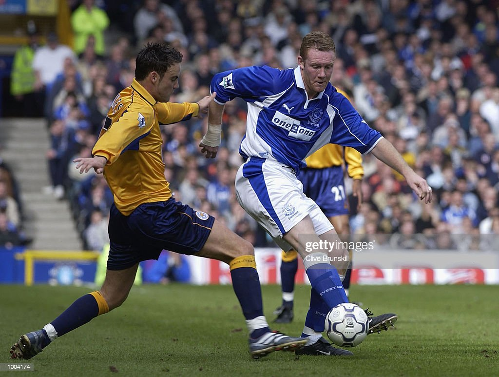 Steve Watson of Everton is tackled by Stefan Oakes of Leicester during the Everton v Leicester City FA Barclaycard Premiership match at Goodison Park, Everton. DIGITAL IMAGE Mandatory Credit: CLIVE BRUNSKILL/Getty Images