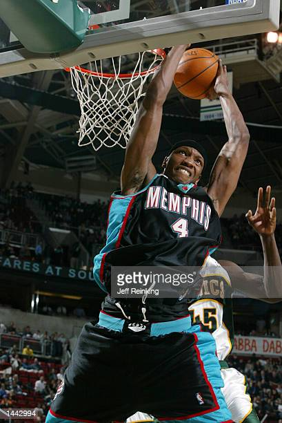Stromile Swift of the Memphis Grizzlies dunks against the Seattle SuperSonics at Key Arena in Seattle Washington DIGITAL IMAGE Note to User User...