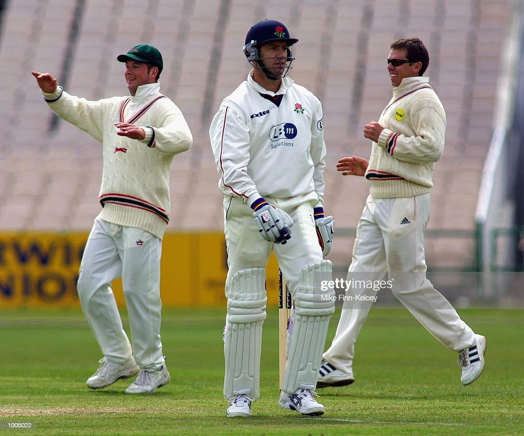 Stuart Law of Lancashire heads back to the pavilion after he was dismissed for 22 by Darren Maddy of Leicestershire during the Frizzell County Championship match between Lancashire ans Leicestershire at Old Trafford, Manchester. DIGITAL IMAGE Mandatory Credit: Mike Finn Kelcey/Getty Images