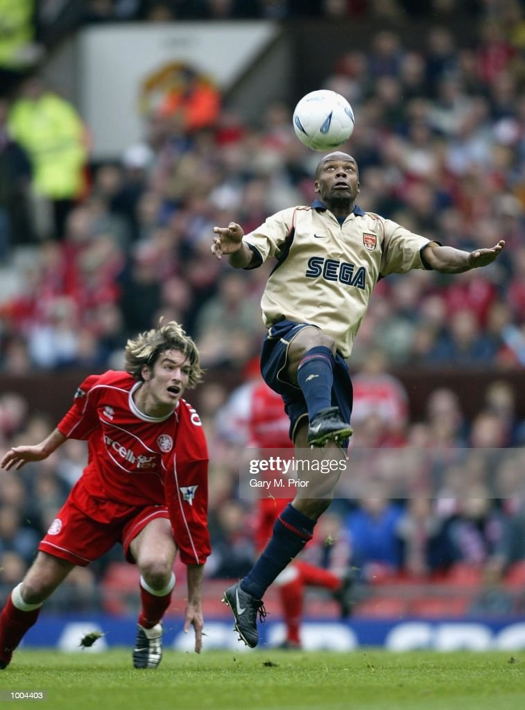 Sylvain Wiltord of Arsenal holds off Franck Queudrue of Boro during the AXA sponsored FA Cup semi final tie between Middlesbrough v Arsenal at Old Trafford Stadium, Manchester. DIGITAL IMAGE. Mandatory Credit: Gary M. Prior/Getty Images