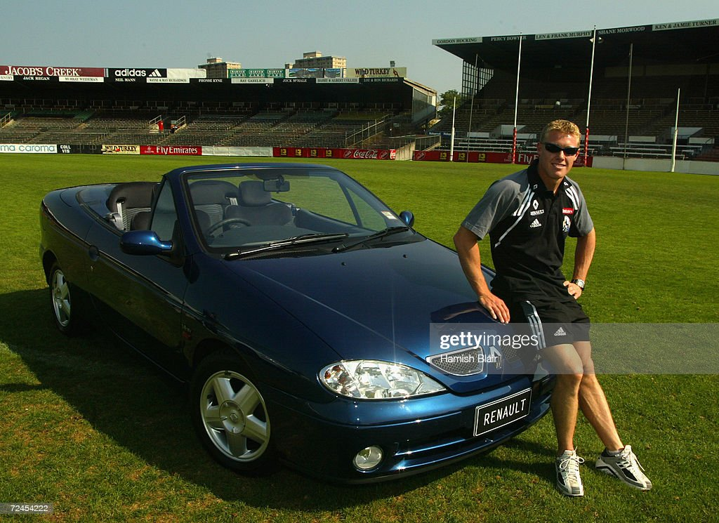 Tarkyn Lockyer poses with a Renault car during a Collingwood Press Conference announcing Renault as a major sponsor at Victoria Park Melbourne...