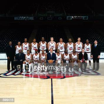 The Houston Rockets coaches and players pose for portrait top row Keith Jones Tierre Brown Terence Morris Eddie GriffinKevin Willis Jason Collierr...