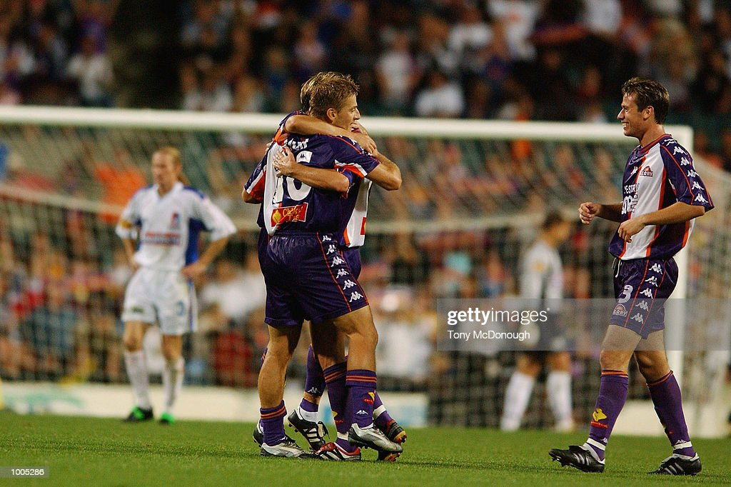 The Perth Glory players embrace during the major semi-final first leg between Perth Glory v Newcastle United, played at the Subiaco Oval DIGITAL IMAGE Mandatory Credit: Tony McDonough/Getty Images