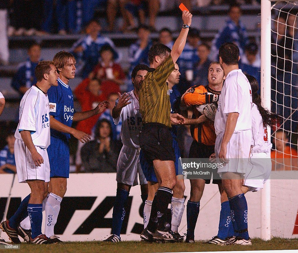 The referee shows the red card to Joel Porter #9 of the Knights during the NSL Elimination Final between the Olympic Sharks and the Melbourne Knights held at Toyota Park, Sydney, Australia. DIGITAL IMAGE. Mandatory Credit: Chris McGrath/Getty Images