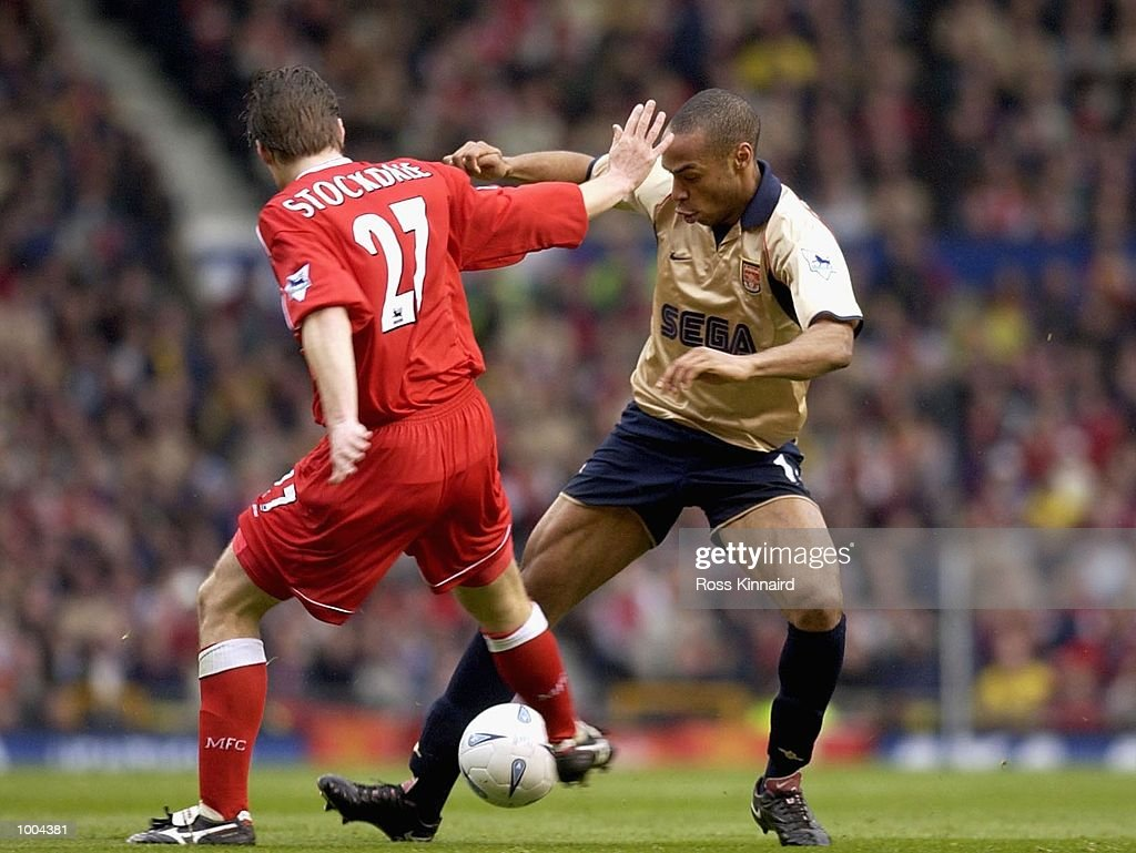 Thierry Henry of Arsenal holds off Robbie Stockdale of Boro during the AXA sponsored FA Cup semi final tie between Middlesbrough v Arsenal at Old Trafford Stadium, Manchester. DIGITAL IMAGE. Mandatory Credit: Ross Kinnaird/Getty Images