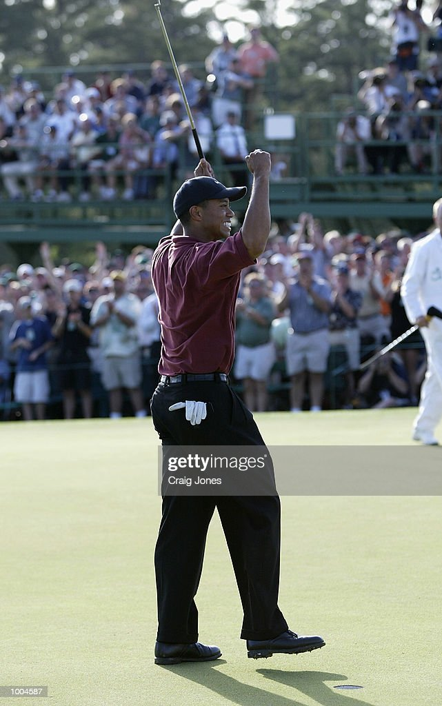 Tiger Woods of the USA celebrates after his victory on the 18th green during the final round of the Masters Tournament from the Augusta National Golf Club in Augusta, Georgia. DIGITAL IMAGE. EDITORIAL USE ONLY Mandatory Credit: