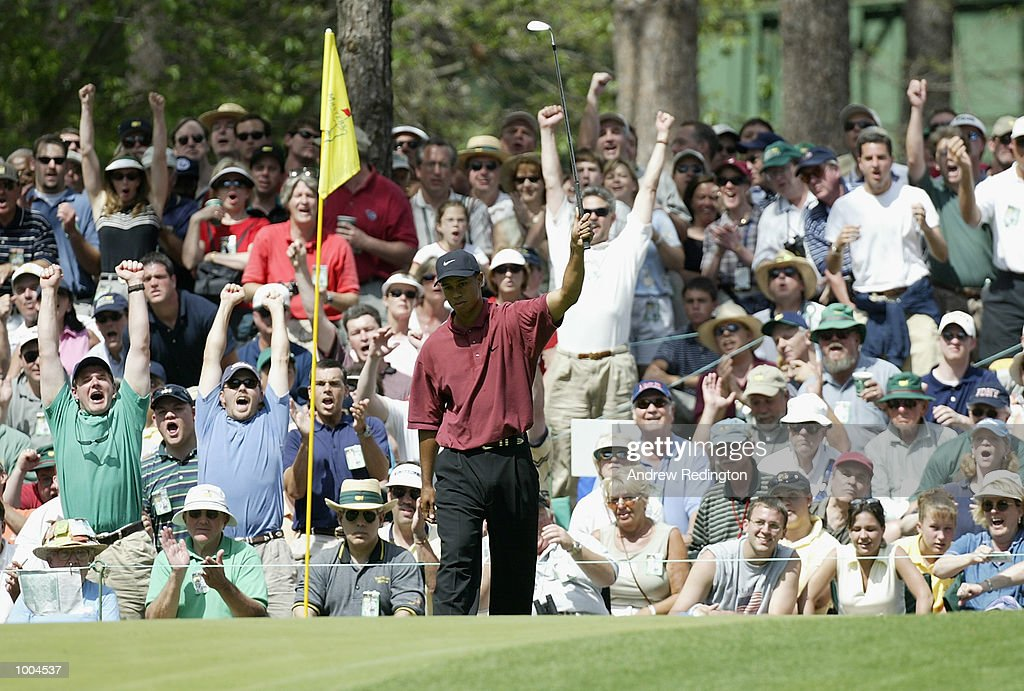 Tiger Woods of the USA celebrates his chip in on the sixth green during the final round of the Masters Tournament from the Augusta National Golf Club in Augusta, Georgia. DIGITAL IMAGE. EDITORIAL USE ONLY Mandatory Credit: Andrew Redington/Getty Images