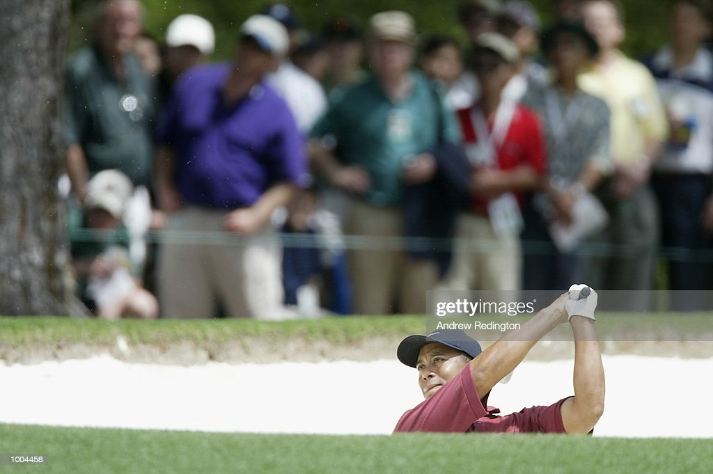 Tiger Woods of the USA plays his second shot from the bunker on the first hole during the final round of the Masters Tournament from the Augusta National Golf Club in Augusta, Georgia. DIGITAL IMAGE. EDITORIAL USE ONLY Mandatory Credit: Andrew Redington/Getty Images