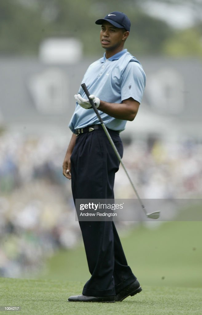 Tiger Woods of the USA plays his second shot on the first hole during the third day of the Masters Tournament from the Augusta National Golf Club in Augusta, Georgia. DIGITAL IMAGE. EDITORIAL USE ONLY Mandatory Credit: Andrew Redington/Getty Images