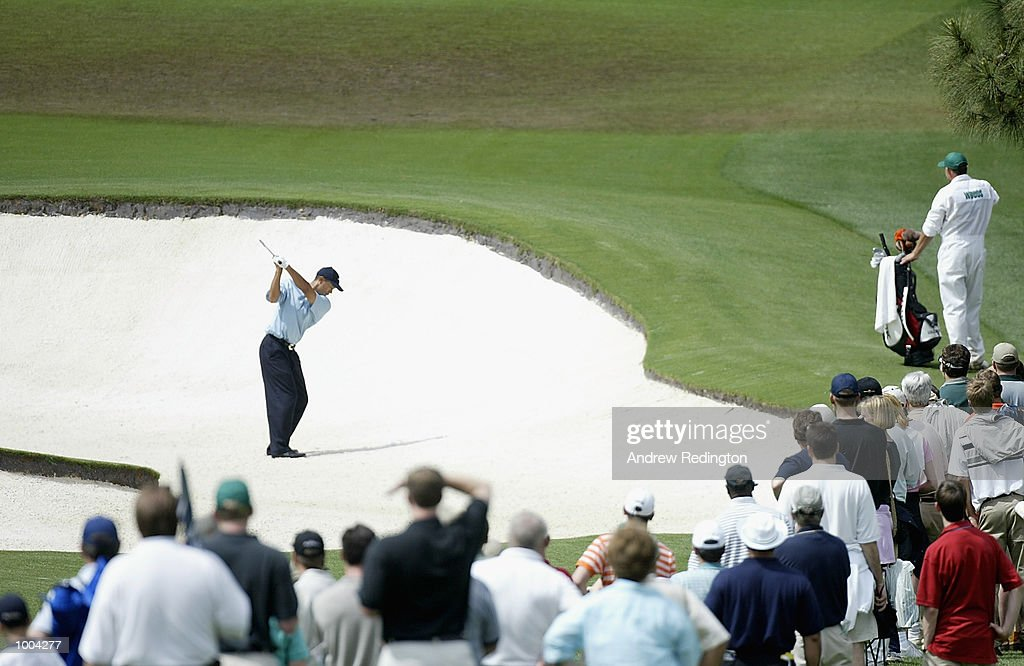 Tiger Woods of the USA plays out of the bunker on the eighth fairway during the third day of the Masters Tournament from the Augusta National Golf Club in Augusta, Georgia. DIGITAL IMAGE. EDITORIAL USE ONLY Mandatory Credit: Andrew Redington/Getty Images