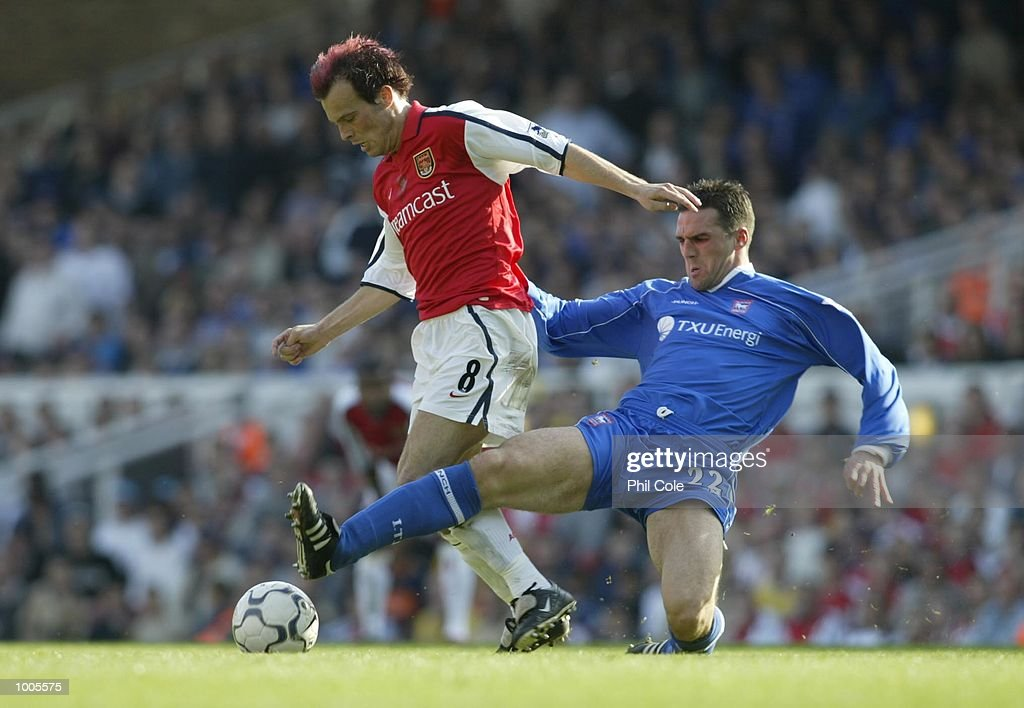 Tommy Miller of Ipswich Town tries to tackle Fredrik Ljungberg of Arsenal during the FA Barclaycard Premiership match between Arsenal and Ipswich Town at Highbury, London. DIGITAL IMAGE Mandatory Credit: Phil Cole/Getty Images
