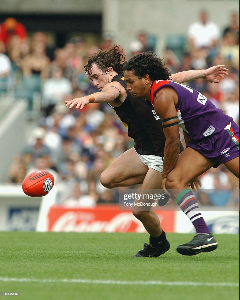 Troy Cook #10 for the Dockers tackles Clinton King #21 for the Tigers during the AFL match between the Fremantle Dockers and the Richmond Tigers, played at the Subiaco Oval, Western Australia. DIGITAL IMAGE. Mandatory Credit: Tony McDonough/Getty Images