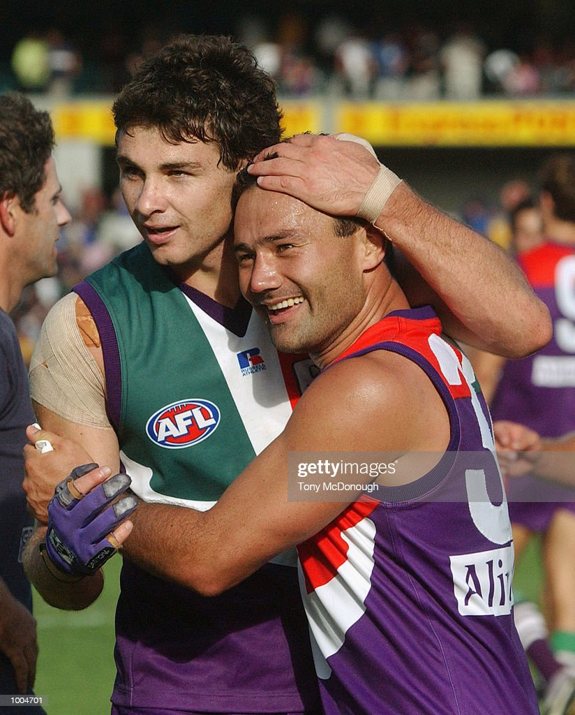 Troy Longmuir #21 and Peter Bell #32 for the Fremantle celebrate after winning round two AFL match between the Fremantle Dockers and St Kilda Saints played at Subiaco Oval in Western Australia.Mandatory Credit: Tony McDonough/Getty Images