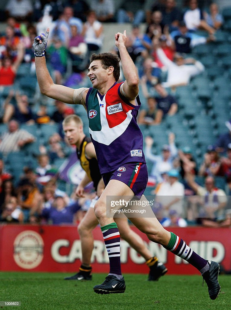 Troy Longmuir #21 for the Dockers celebrates a goal after defeating Richmond during the AFL match between the Fremantle Dockers 138 points and the Richmond Tigers 72 points, played at the Subiaco Oval, Western Australia. DIGITAL IMAGE. Mandatory Credit: Tony McDonough/Getty Images