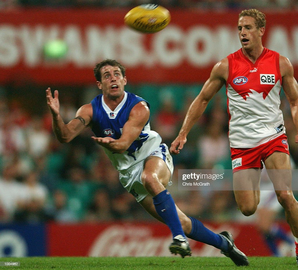 Troy makepeace #35 of the Kangaroos dives for a mark during the round 4 AFL match between the Sydney Swans and the Kangaroos held at the Sydney Cricket Ground, Sydney, Australia. DIGITAL IMAGE. Mandatory Credit: Chris McGrath/Getty Images
