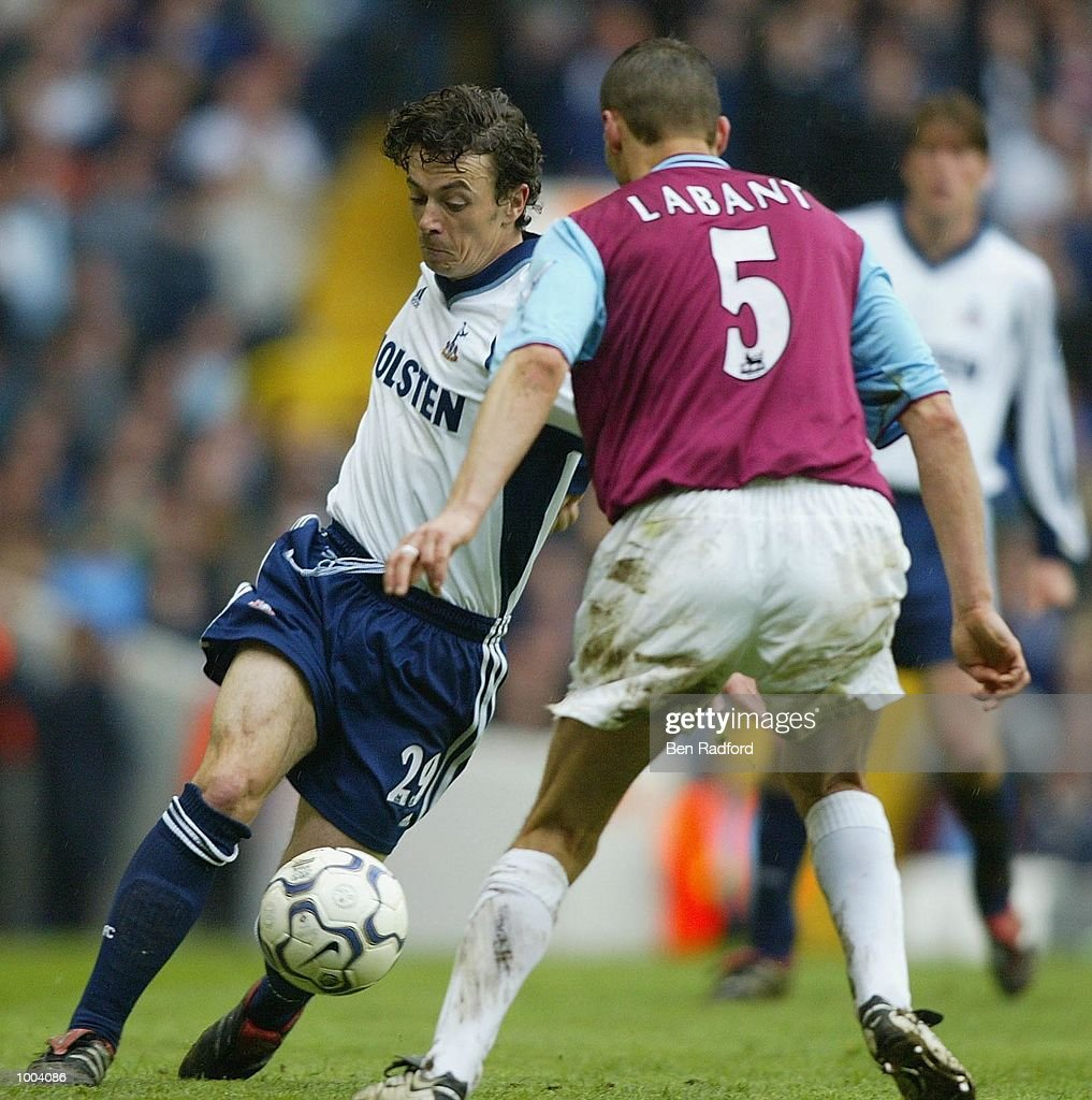 Vladimir Labant of West Ham tries to tackle Simon Davies of Tottenham Hotspur during the FA Barclaycard Premiership match between Tottenham Hotspur and West Ham United at White Hart Lane, London. DIGITAL IMAGE Mandatory Credit: Ben Radford/Getty Images