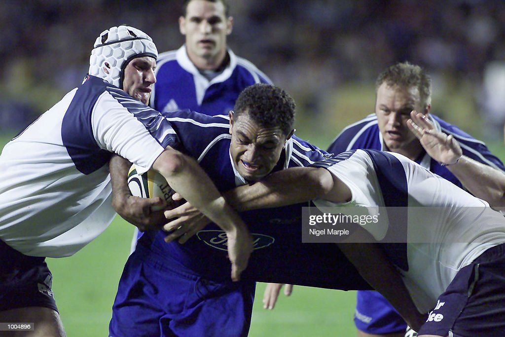 Vula Maimuri #4 of the Blues is tackled near the line by the Bulls defence during the Super 12 game between the Blues of New Zealand and the Bulls of South Africa at Eden Park, Auckland, New Zealand. The Blues won 65-24. DIGITAL IMAGE. Mandatory Credit: Nigel Marple/Getty Images