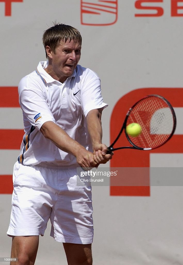 Yevgeny Kafelnikov of Russia plays a backhand on his way to defeat by Stefano Galvani of Italy during the Open Seat Godo 2002 held in Barcelona, Spain. DIGITAL IMAGE Mandatory Credit: Clive Brunskill/Getty Images