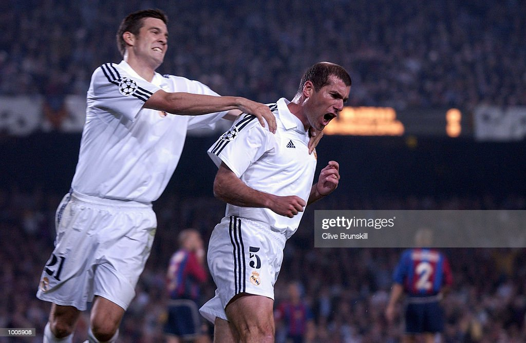 Zinedine Zidane of Real Madrid celebrates with Santiago Solari after scoring the first goal during the UEFA Champions League Semi Final First Leg match between Barcelona and Real Madrid at the Nou Camp, Barcelona, Spain. DIGITAL IMAGE Mandatory Credit: Clive Brunskill/Getty Images