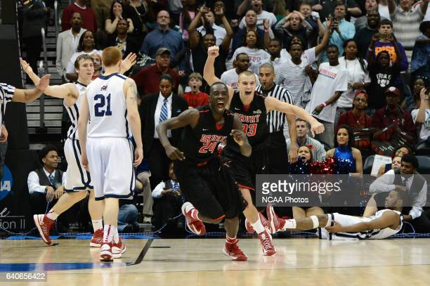 Cameron Adams and Alex Hall of Drury University celebrate after defeating Metro State University during the Division II Men's Basketball Championship...