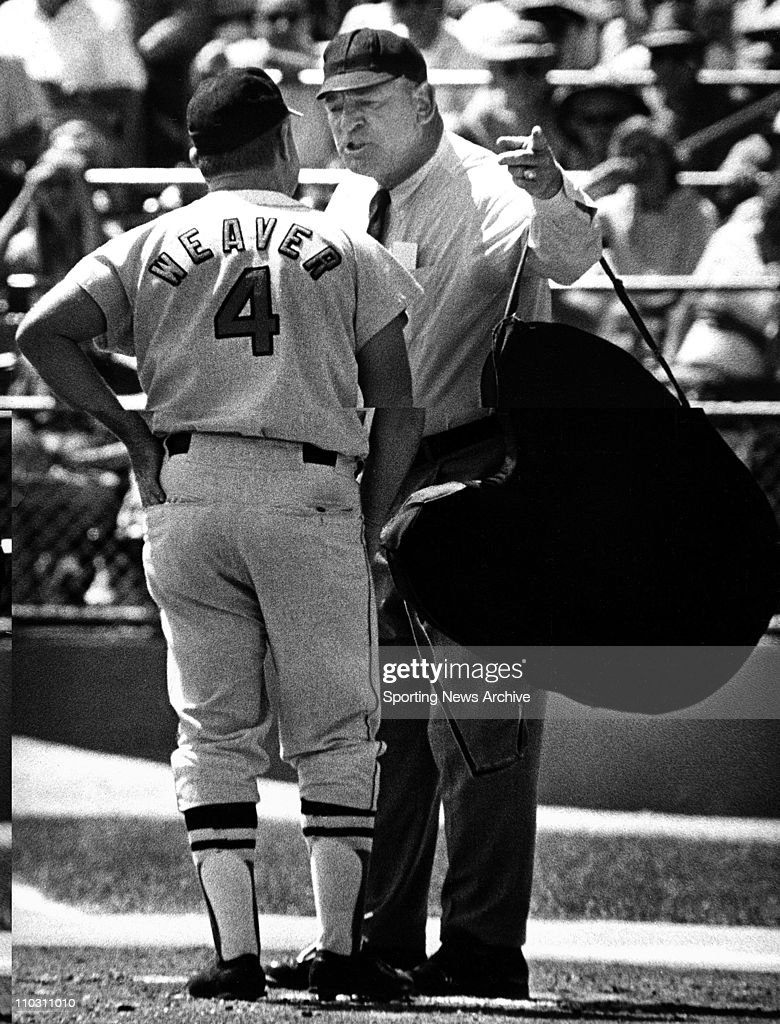 Apr 25, 1969 - Baltimore, Maryland, USA - EARL WEAVER of the Baltimore Orioles with Umpire is FRANK UMONT