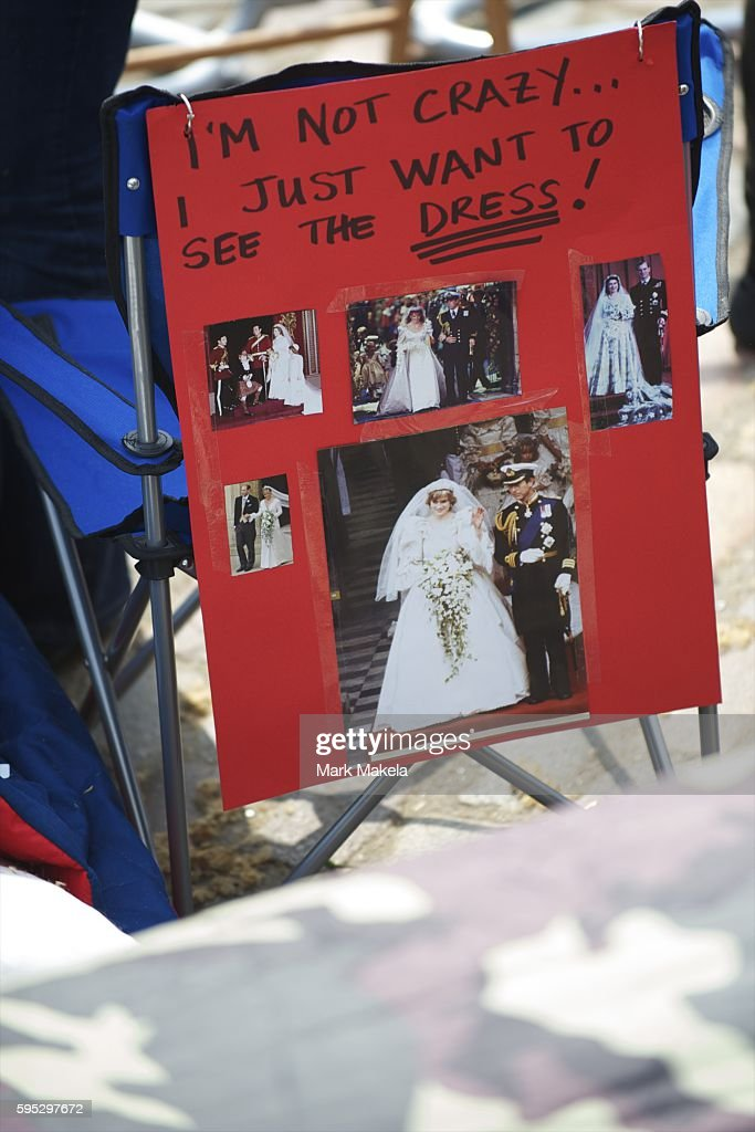 Apr 28 2011 London United Kingdom A tourist camper at Westminster Abbey adorns the back of her lawn chair with an energetic placard The medieval...