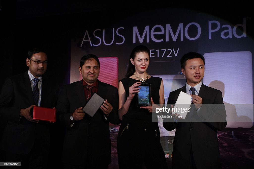 Apratim Sharma Country Product Manager, ASUS India, Unaez Quraishi Sales & Distribution Director-System Business Group ASUS India and Peter Chang Regional Head-Southern Asia &Country Manager-System Business Group-ASUS India unveiling ASUS MeMO Pad 172V on February 27, 2013 in New Delhi, India. The tablet is powered with 1GHz processor and 1GB RAM. It comes with 8GB internal memory with support for an expandable memory card slot. The device is priced at Rs 9,999.