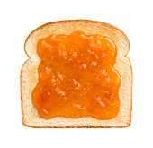 Straight on vew of Apricot Preserves on a single slice of lightly toasted white bread.  This is ideal to serve at breakfast time.  Apricots are a juicy, soft fruit, resembling a small peach.  They ar