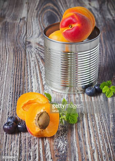 apricots and blueberries in an iron pot
