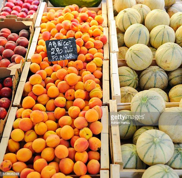 Apricots, melons and peaches freshly-picked on sale at farmer's market in France