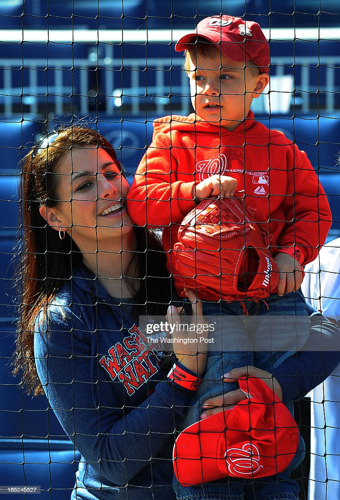 Jacob Thomas Nadherny, 3, with his mom, Kathy Nadherny, of Arlington, watch the Nationals batting practice as the Nationals take on the Miami Marlins on opening day of the 2013 baseball season on April 1, 2013 in Washington, DC. Jacob came to his first opening day when he was two weeks old and has been to each opening day since.