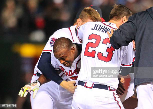 Atlanta Braves left fielder Justin Upton emerges from the celebration after driving in the winning run in the Atlanta Braves 76 victory in extra...