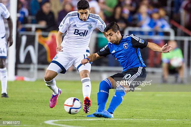 San Jose Earthquakes midfielder Matias Perez Garcia passes the ball past Vancouver FC midfielder Matias Laba during an MLS soccer game between the...