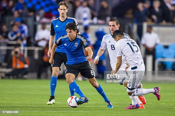 San Jose Earthquakes midfielder Shea Salinas breaks past Vancouver FC midfielder Matias Laba during an MLS soccer game between the San Jose...