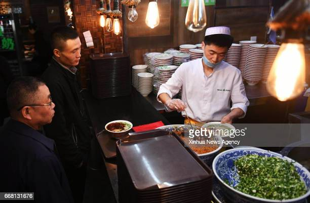 LANZHOU April 13 2017 A chef prepares a bowl of beef noodle at a noodle restaurant in Lanzhou capital of northwest China's Gansu Province April 12...