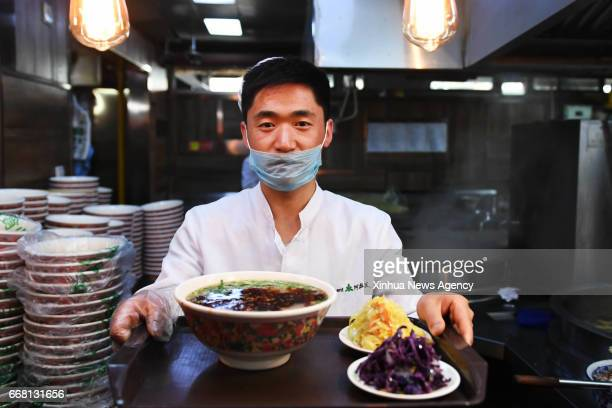 LANZHOU April 13 2017 A chef shows a package meal of beef noodle at a noodle restaurant in Lanzhou capital of northwest China's Gansu Province April...