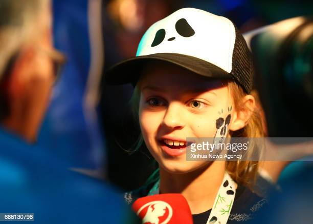 AMSTERDAM April 13 2017 A girl speaks to media as she waits for pandas at Schiphol airport in Amsterdam the Netherlands on April 12 2017 Wu Wen and...