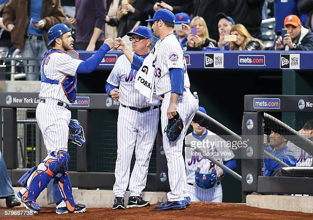 New York Mets Starting pitcher Matt Harvey [8336] fist bumps battery mate Travis d'Arnaud [7075] as pitching coach