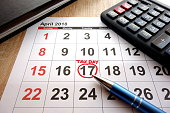 April 17 2018 marked as tax day on calendar in office