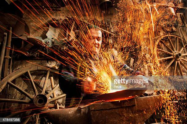 April 17 Lahij Ismailli Region Shirvan Azerbaijan In his shop a coppersmith heats and pounds copper to make a plate Lahij is the old center for...