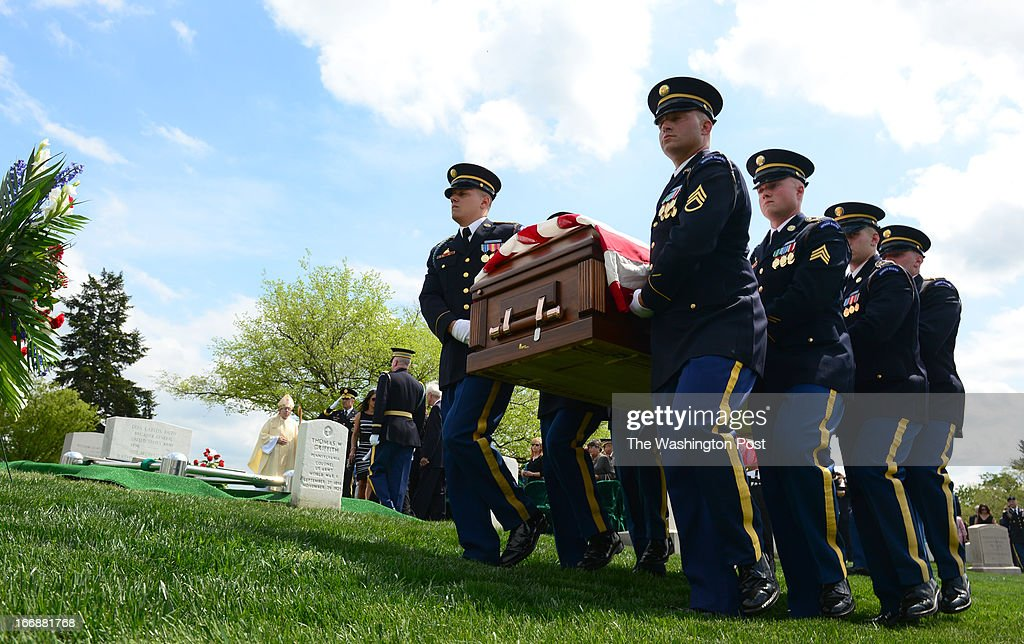 Members of the U.S. Army's 3rd Infantry Regiment 'The Old Guard' carry the coffin of U.S. Army Lt. Col. Don Carlos Faith Jr., a Medal of Honor recipient killed in the Korean War, to his grave site in section 4 on a hillside in Arlington National Cemetery on April 17 2013 in Arlington, VA
