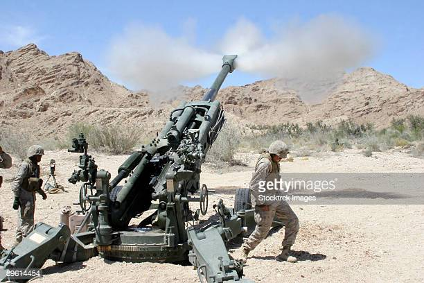 April 18, 2006 - Marines shoot 100-pound rounds from their M777 Lightweight Howitzer during a firing mission in Niland, California.