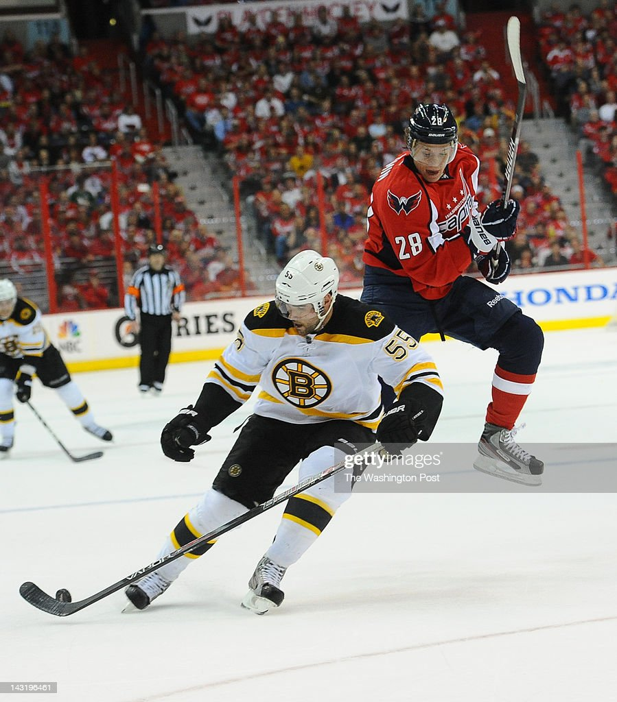 WASHINGTON, DC April 19, 2012 Washington Capitals left wing Alexander Semin (28) leaps around Boston Bruins defenseman Johnny Boychuk (55) while going after the puck during 1st period action on April 19, 2012 in Washington, DC