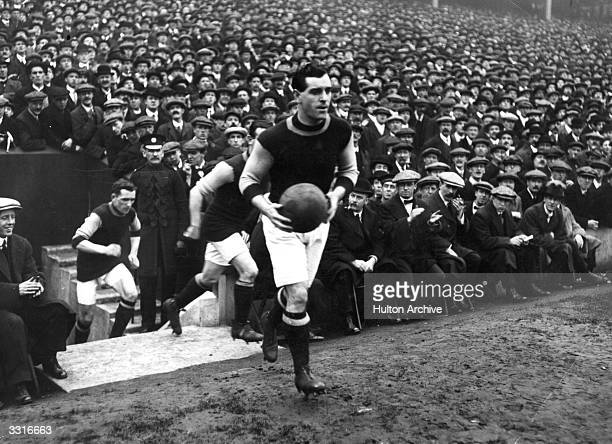 Burnley captain Tom Boyle leads his team onto the pitch for their FA Cup semifinal replay against Sheffield United at Liverpool