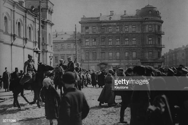 Russian Cossaks keep a watchful eye on the townsfolk during their occupation of Lemberg